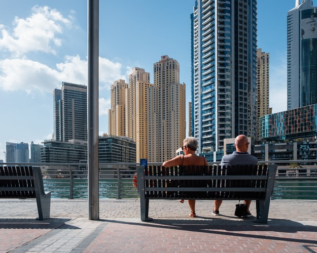 Couple Sitting in Dubai Sunshine